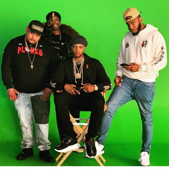 Papoose pose for a photo with his friends.