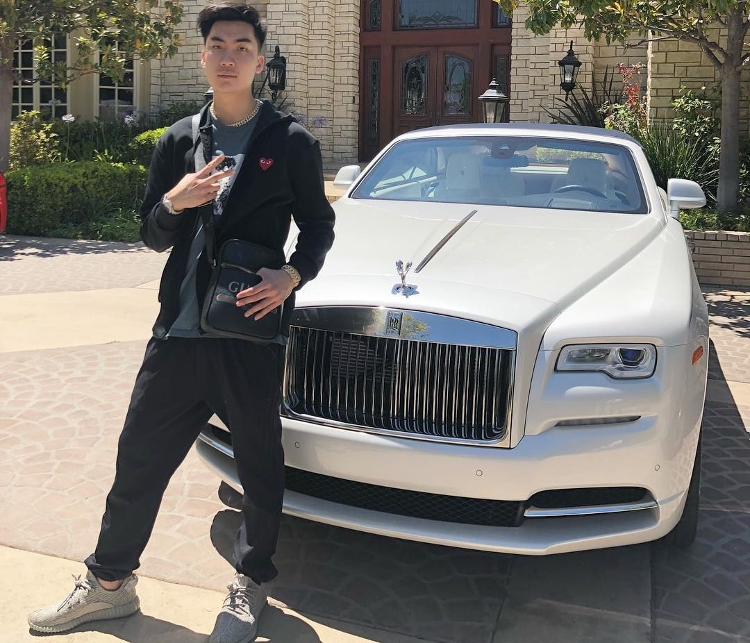 RiceGum poses with his White Rolls Royce.
