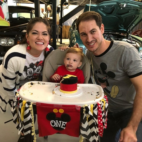 A picture of Joey Logano and his wife, Brittany Baca celebrating their son's 1st birthday.