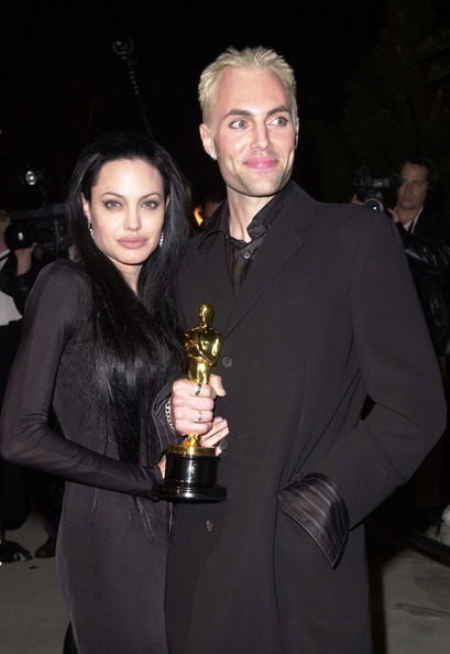 James Haven and his sister Angelina Jolie posing for a photo with Angelina Oscar award.