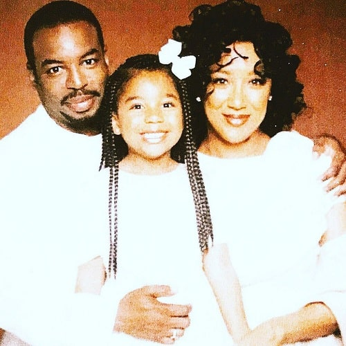 A picture of Michaela Jean Burton with her parents.