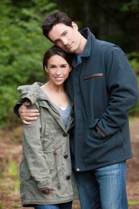 David Nehdar and Lacey Chabert taking a picture together.