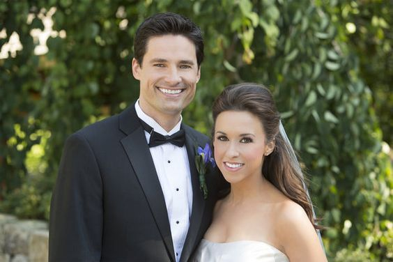 David Nehdar and Lacey Chabert taking a picture after their marriage ceremony.