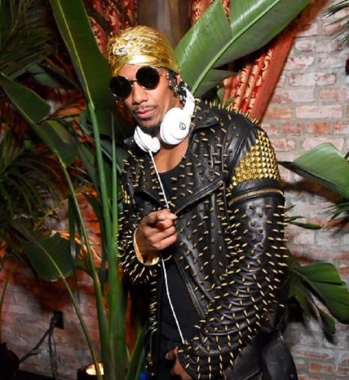 Nick Cannon in a funky golden turban