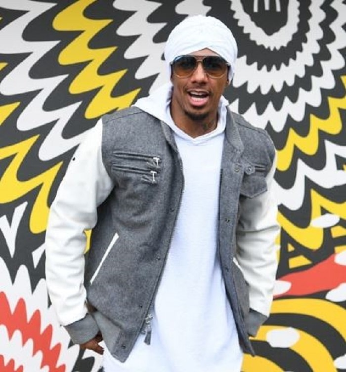 Nick Cannon in a white turban.
