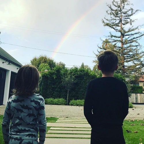 A picture of Leo Grey McElhenney with his elder brother, Alex Lee McElhenney admiring a rainbow.