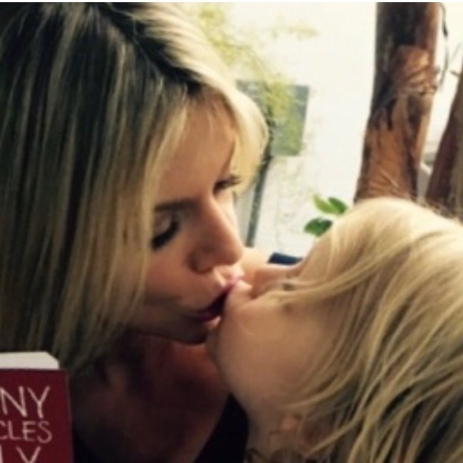 A picture of Leo Grey McElhenney kissing his mother, Kaitlin Olson.