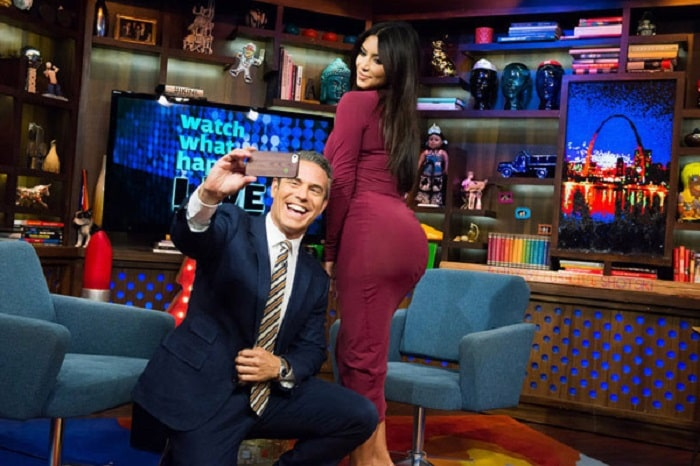 Andy Cohen taking a selfie with Kim's butt