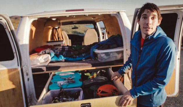 Alex Honnold checking his gear on his van.