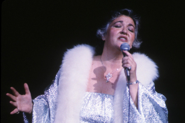 Morgana King performing live on a stage.