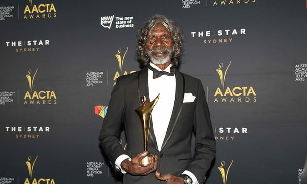 David Gulpilil take a picture with his AACTA Award.