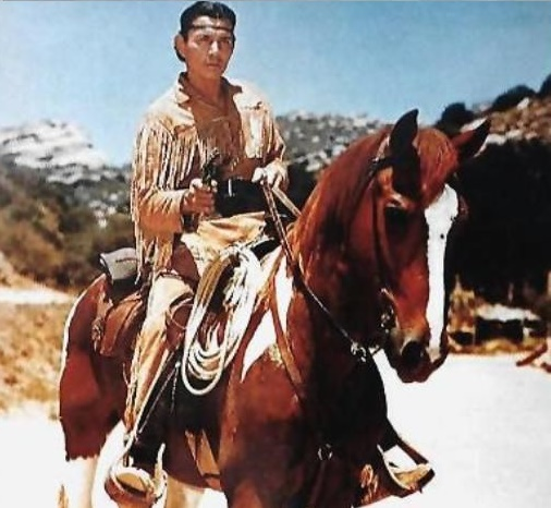 Jay Silverheels riding horse in the set of The Lone Ranger.
