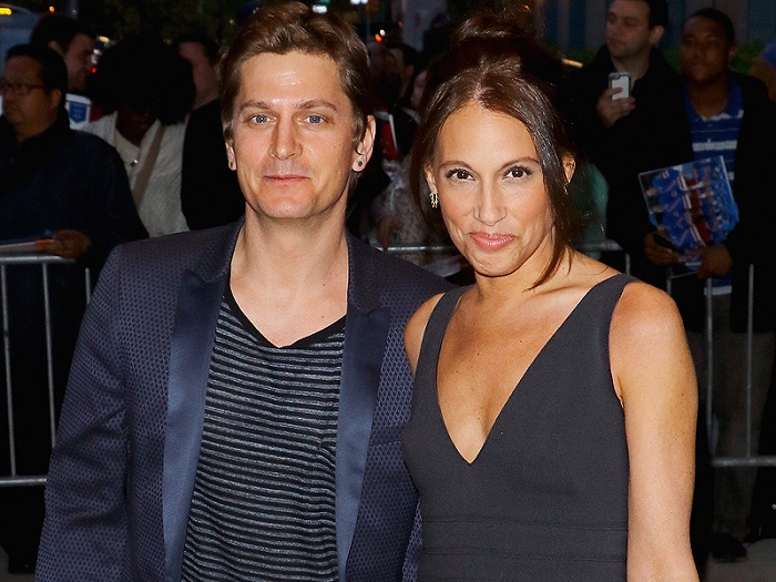 Marisol Maldonado with her husband Rob Thomas taking a picture.