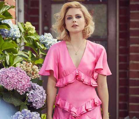 Rose McIver poses for a picture in garden of her house.