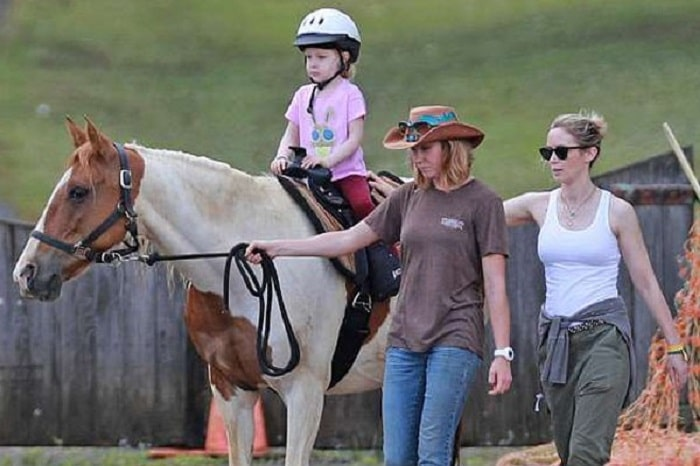Hazel's quick horse riding session with her mommy.