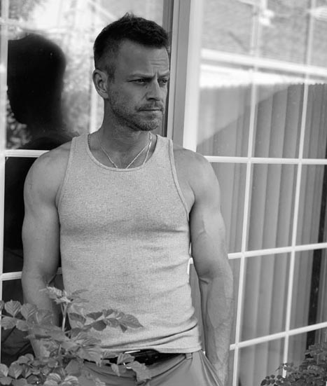 Carmine Giovinazzo poses for a picture for Insta post.