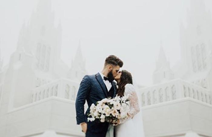 kayla Harper and Bryce Harper kissing on their wedding day.