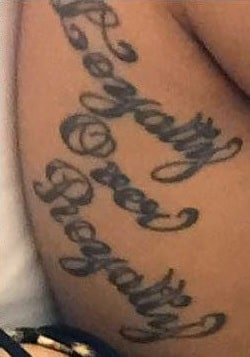 A picture of 'Loyalty Over Beauty' tat of Cardi B.