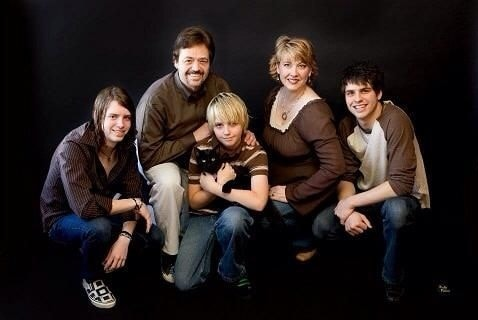 A picture of Jay Osmond with his wife and kids.