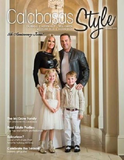 Jay and his children and wife featured in the cover of a magazine.