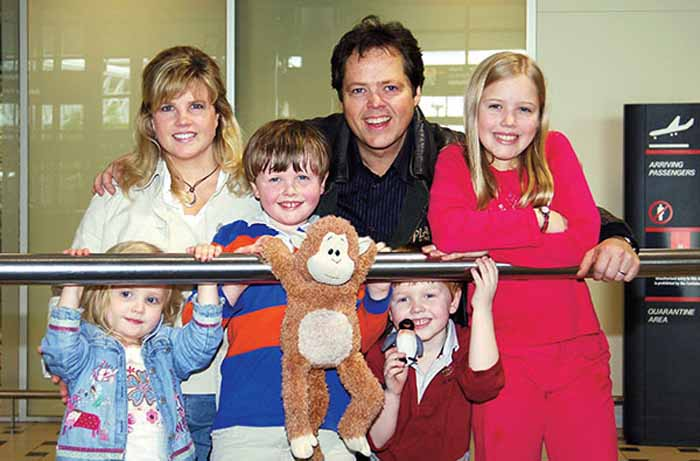 Jimmy Osmond taking a picture with his family.