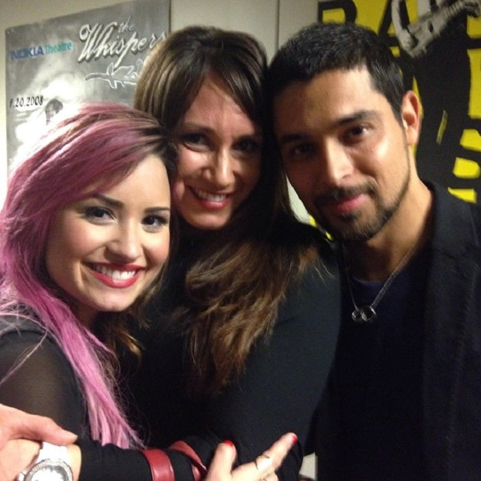 Amber with her sister Demi Lovato and her boyfriend (now ex) Wilmer Valderrama.