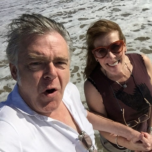 A picture of Kevin McNally travelling with his wife.