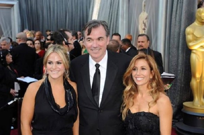 Tara with her husband and her step daughter at a red carpet event.