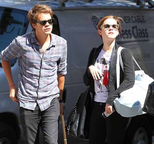 Johnny Simmons and Emma Watson got caught together on camera.