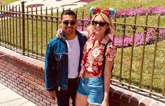 Amanda Pacheco and Wilmer Valderrama taking a photo together.