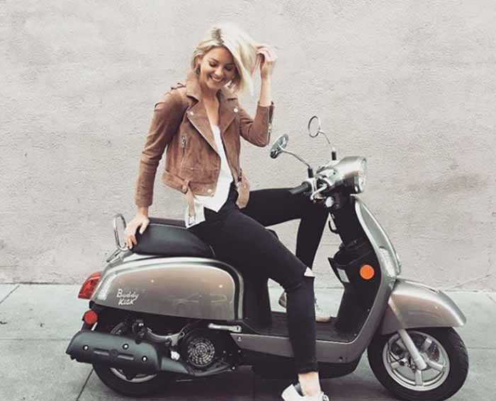 Amanda Pacheco poses with a scooter.