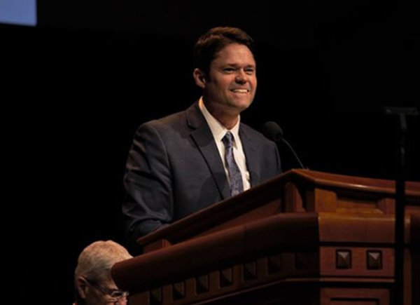 Justin Osmond giving a speech.