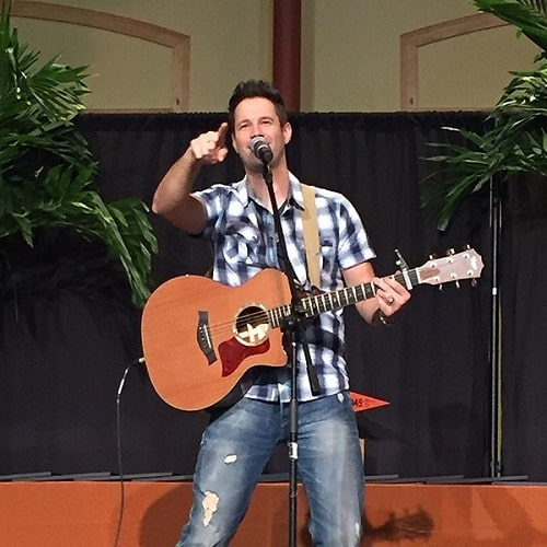 A picture of David Osmond performing live.