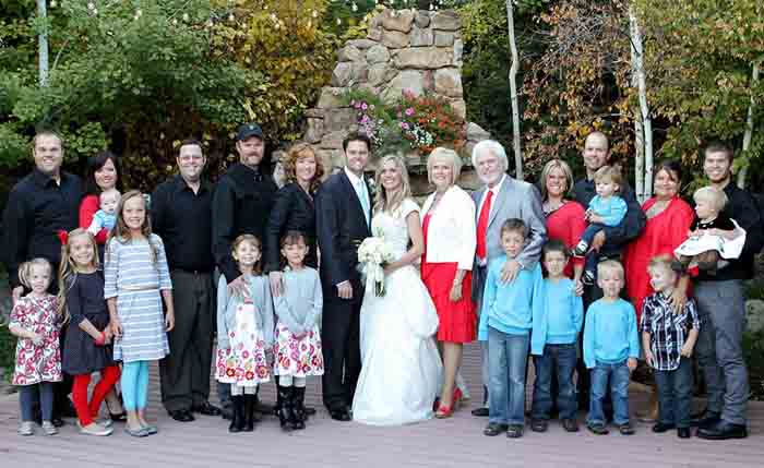 Merrill Osmond family taking group photo in Justin Marriage.