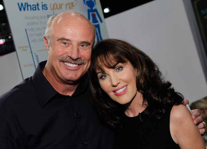 Dr.Phil poses for a picture with his wife Robin McGraw.