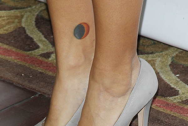 paulina's colorful tattoo of the lunar eclipse