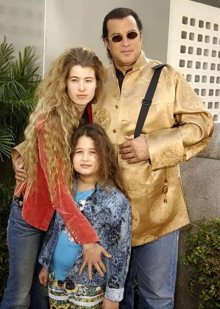 A picture of Savannah Seagal with her parents.