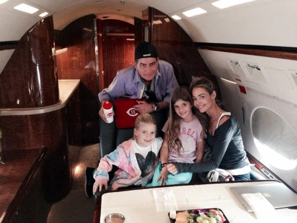 Charlie with his ex-wife Denise and their daughter in the jet plane
