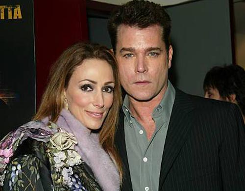 Michelle Messer and Ray Liotta taking a picture together.