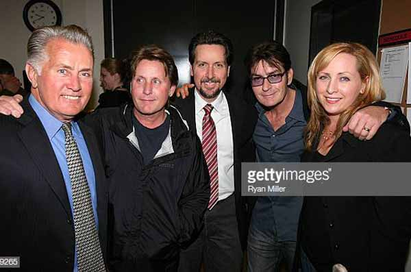 Martin Sheen taking a picture with his children.