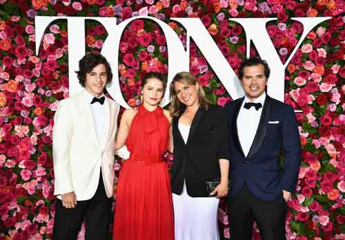 Justine Maurer and John Leguizamo with their children at 2018 Tony Awards.