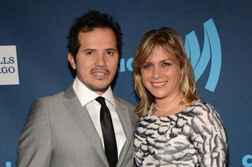 Justine Maurer and John Leguizamo pose for a picture together.