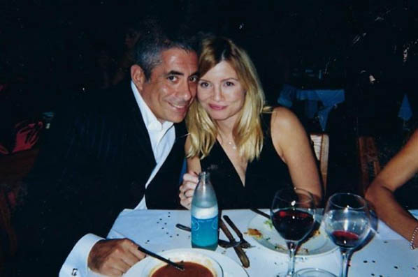 John Macaluso and his wife taking picture together in dinner party.