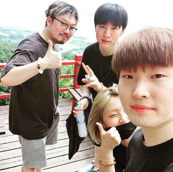 Pdogg posing for a picture with his colleagues.