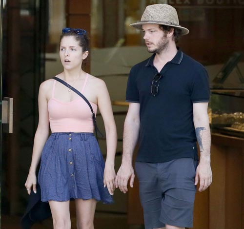 Ben Richardson and Anna Kendrick walking down street together.