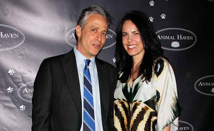 Tracey McShane and Jon Stewart pose for a picture.