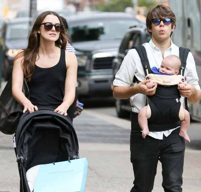 James Righton and his wife Keira Knightley walking down street with the child.