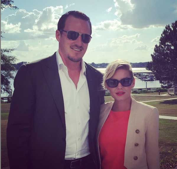 Dion Phaneuf with his wife Elisha Cuthbert.