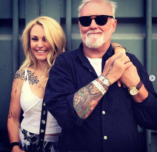 Sarina Taylor and Roger Taylor taking picture together.