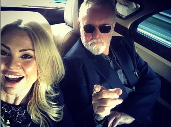 Sarina Taylor with her husband roger Taylor posing for a selfie inside car.